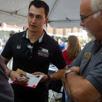 Indy 500 race driver Graham Rahal was a featured guest of IUPUI Motorsports Engineering and program director Pete Hylton, right, during last year's Motorsports Day.