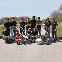 #4 and #7 team pose at the 59th Annual Purdue Grand Prix