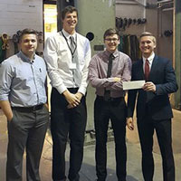 (left to right) Jesse Burton, Zach Wozniak, Cameron Hedrick and Daniel Robinson with first-place certificate for technical design