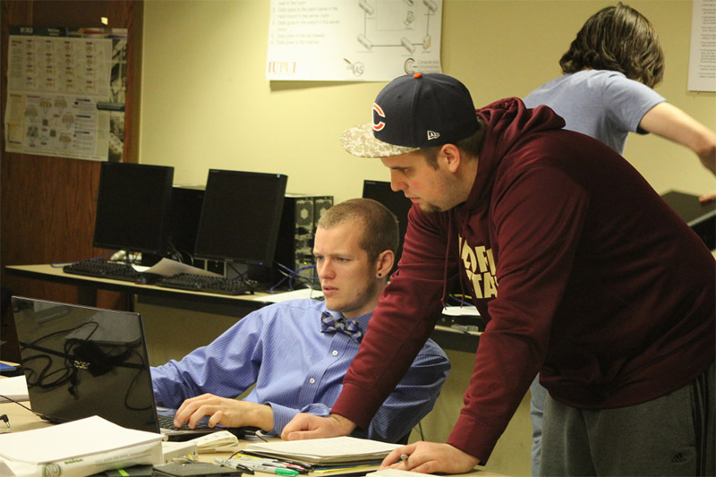 From left to right, Joe Walters and Nick Barnett discuss imaging project management.