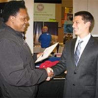 Harold Owens II (left) shaking hands with Jake Todd (right), student at IUPUI, pursuing a Master's degree in Electrical Engineering.